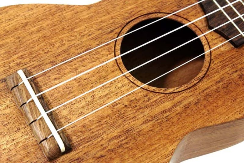 Ukulele strings and soundhole closeup